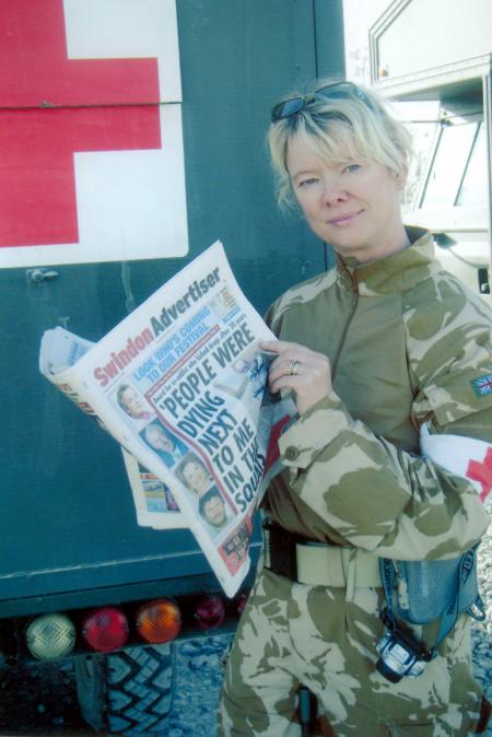 IT'S time to salute Corporal Cheryl Kelser who is pictured reading her copy of the Swindon Advertiser in Afghanistan.