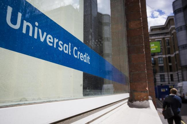 LONDON, ENGLAND - MAY 03: A Universal Credit sign in the window of the Job Centre in Westminster on May 3, 2016 in London, England. The Resolution Foundation, chaired by former Conservative Minister David Willets, has said the Government's benefit ref