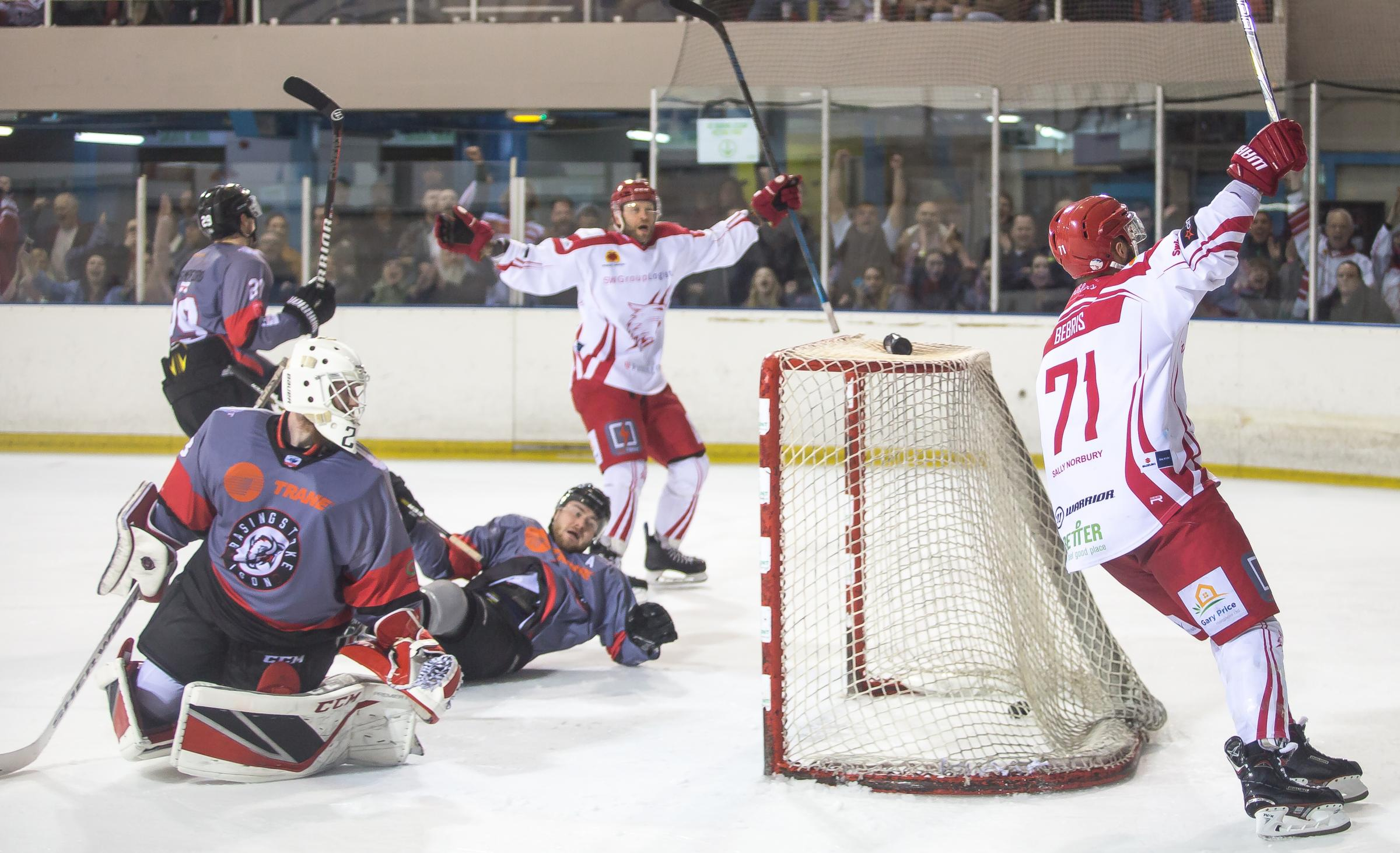 Swindon Wildcats (white) celebrate a goal against Basingstoke Bison on Saturday night. PICTURE: RYAN AINSCOW