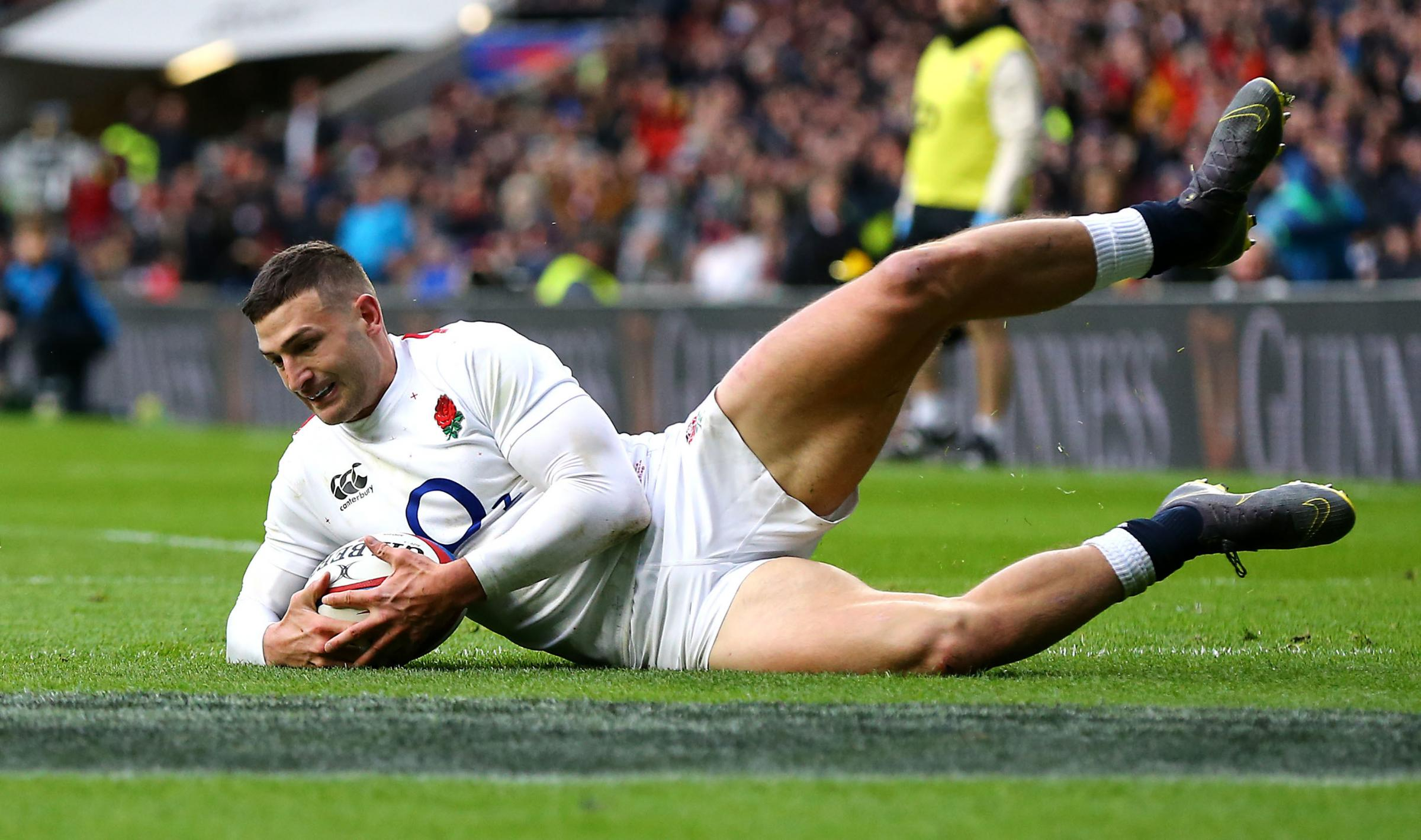 England's Jonny May scores his side's third try of the game during the Guinness Six Nations match at Twickenham Stadium, London..