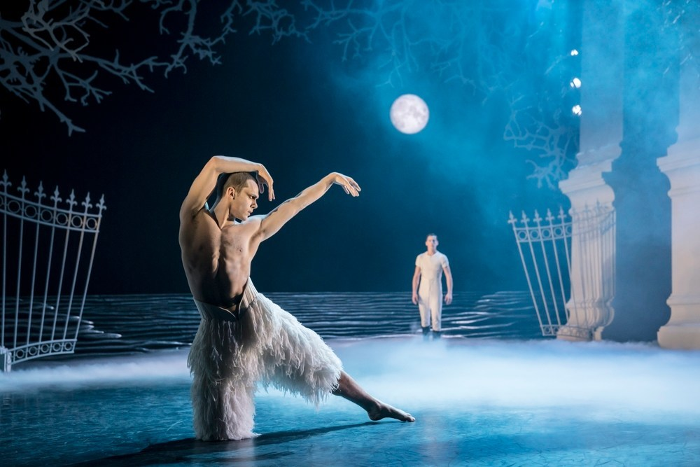 Will Bozier as The Swan/The Stranger and Dominic North as the Prince in Matthew Bourne's Swan Lake