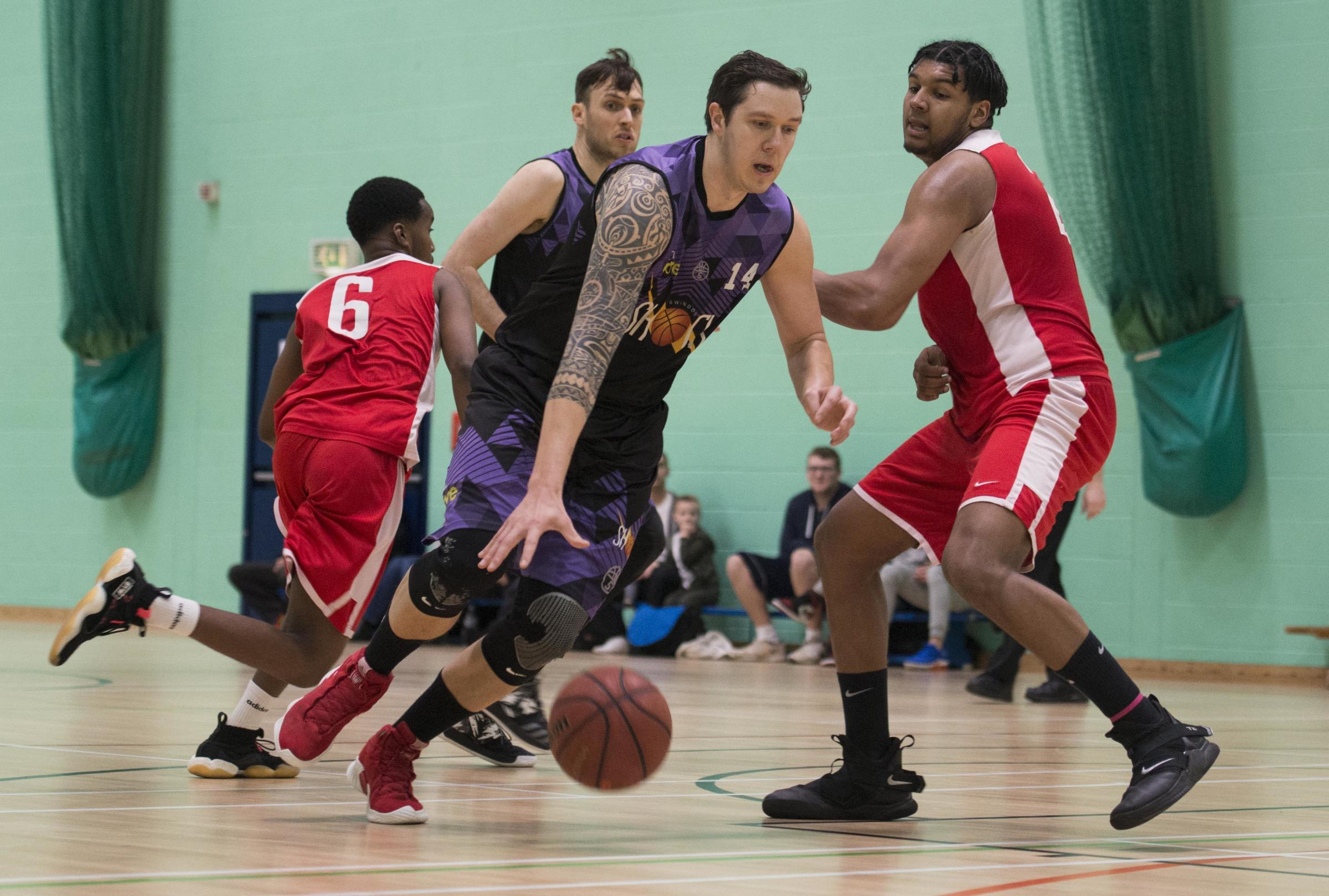 Matt Ford (purple) powers forward for Swindon Shock in their clash at home to Barking Abbey on Saturday                              Picture: WWW.CLAREGREENPHOTOGRAPHY.COM