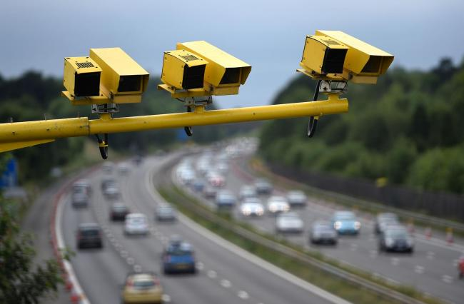 File photo dated 28/06/15 of three SPECS Average Speed cameras in position on the M3 motorway in Hampshire. The number of drivers caught speeding is more than 160 times higher in some parts of England and Wales than others, a study by the RAC Foundation h