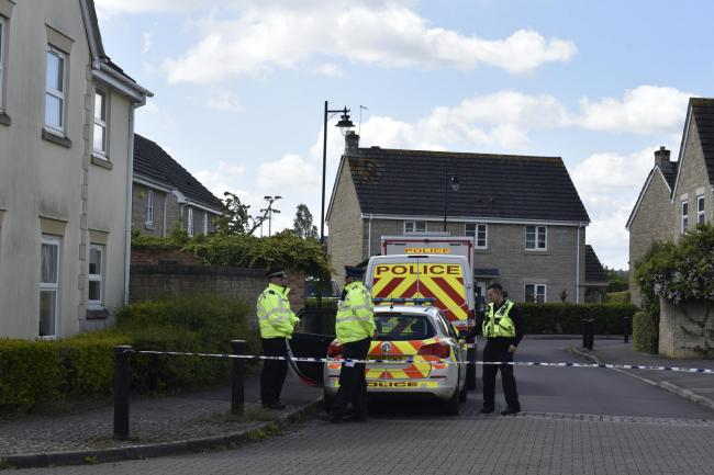 Police at the scene of a murder investigation on Springfield Drive, Calne Picture: GLENN PHILLIPS