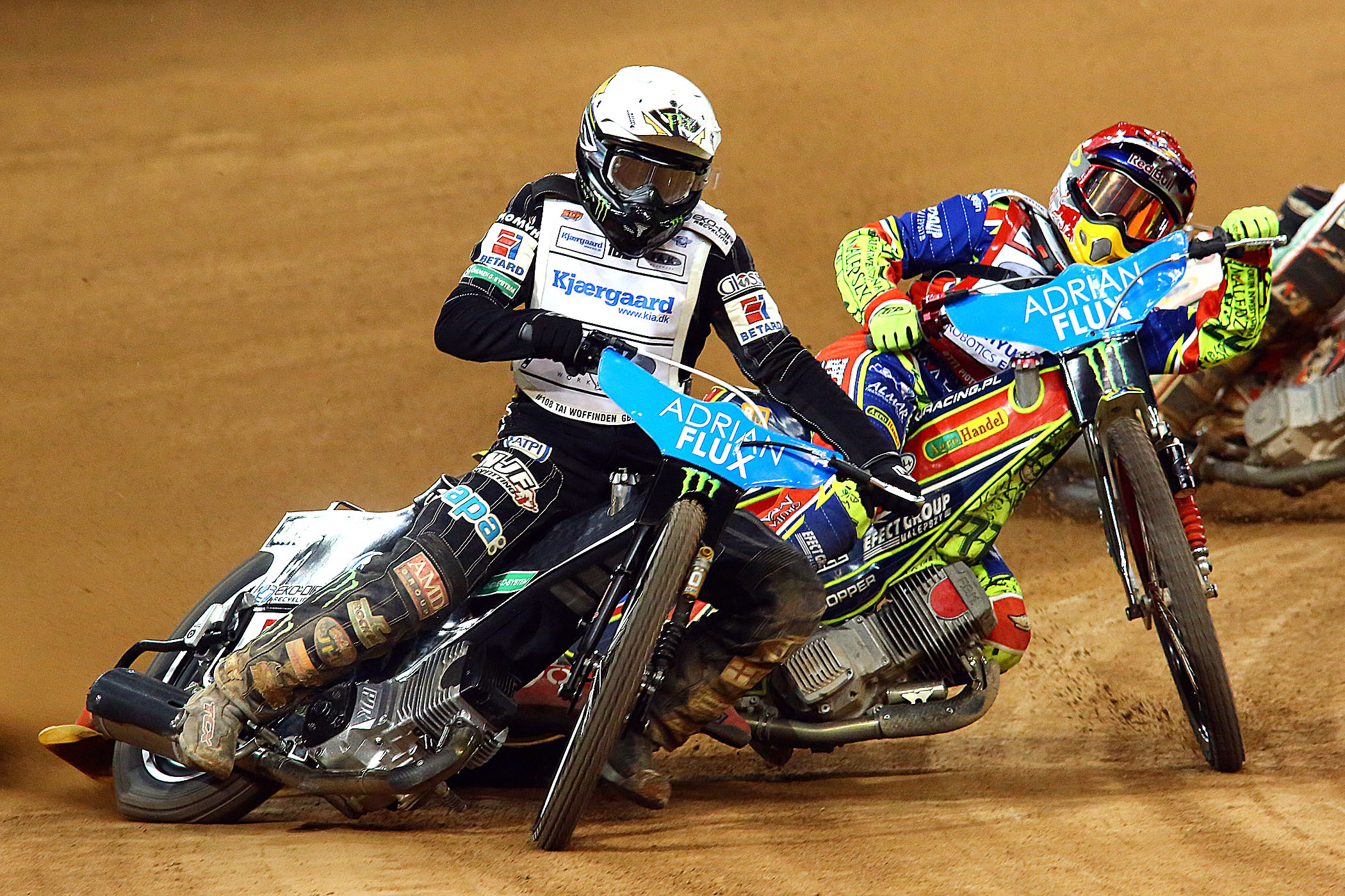 Tai Woffinden & Piotr Pawlicki. British Grand Prix, Saturday, July 9, 2016. Picture: LES AUBREY.