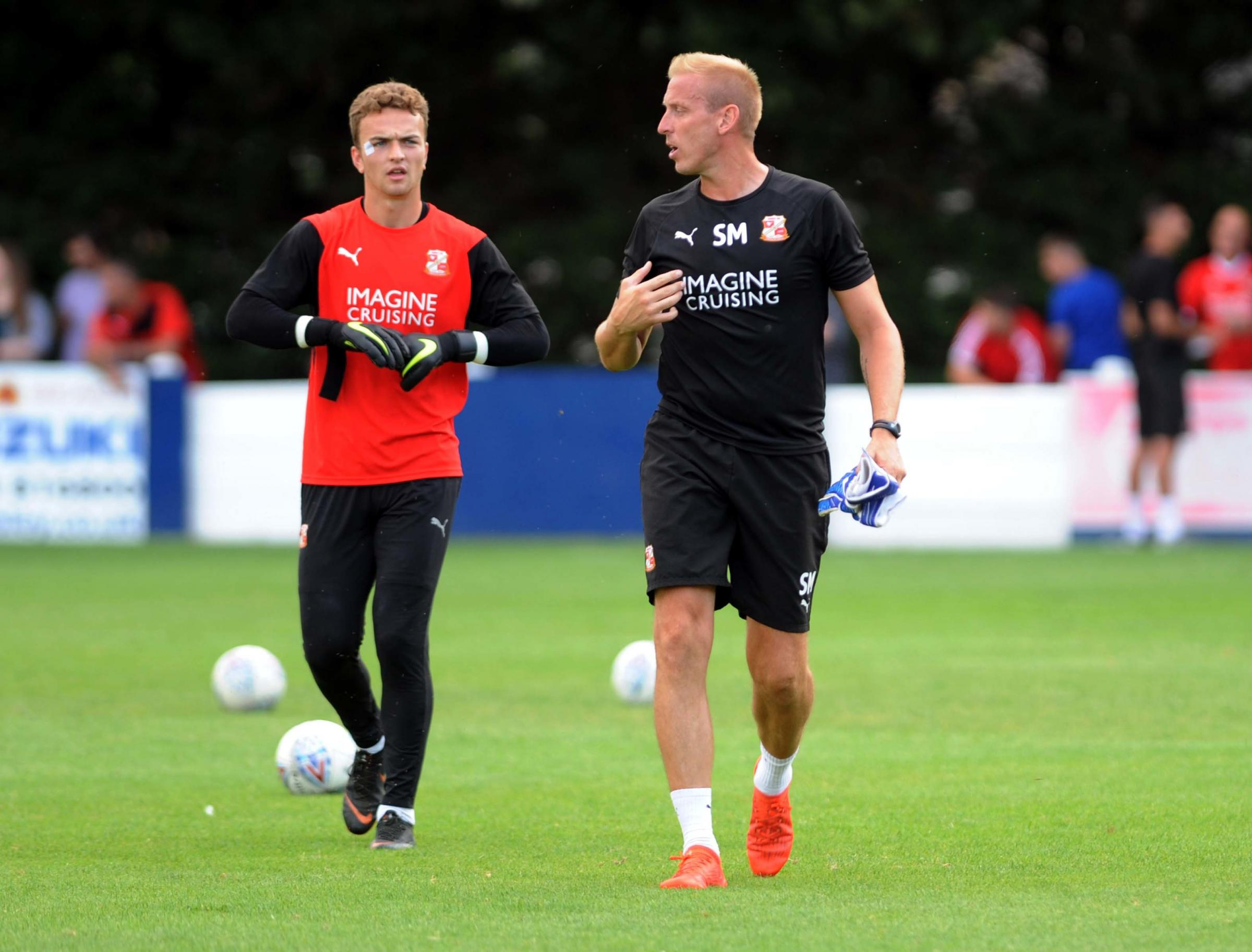 Swindon Supermarine v STFC        Pic Dave Evans   27.7.18.New goalkeepeing coach Steve Mildenhall with Will Henry..