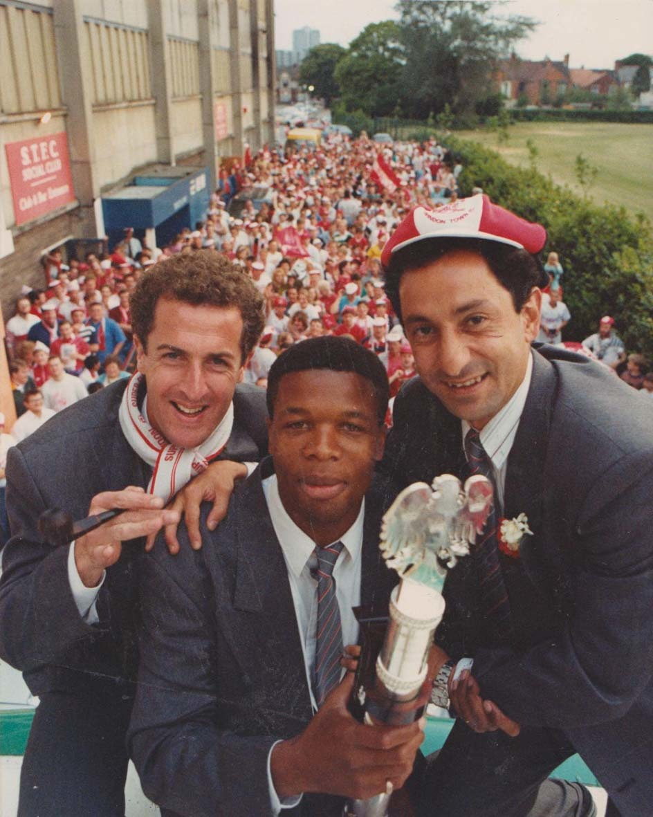 Steve White, Jon Gittens and Ossie Ardiles celebrate Swindon Town's 1990 Division Two play-off final win