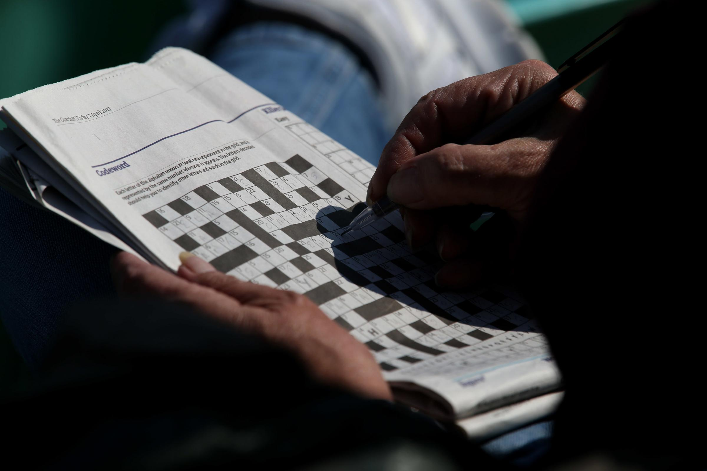 File photo dated 07/04/17 of a person doing a crossword puzzle. According to a study, older adults who regularly do word and number puzzles have sharper brains. PRESS ASSOCIATION Photo. Issue date: Thursday May 16, 2019. The study found the more regularly