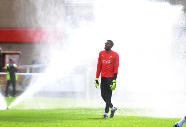 STFC v Bury             Pic Dave Evans           15..09.18.Lawrence Vigouroux warma up beside the sprinklers..