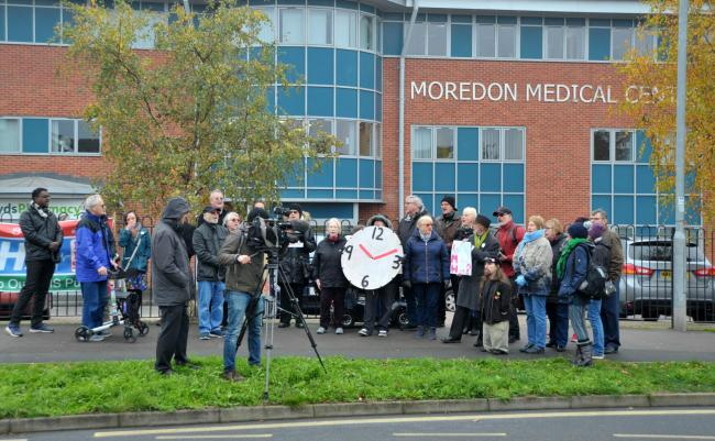 Protestors outside Moredon Medical Centre, which was being run by IMH