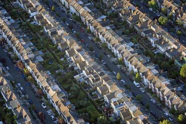 File photo dated 13/8/2017 of an aerial view of terraced houses in south west London. Over half of people renting a home from a local authority or housing association have had a problem with the building in the past three years, including electrical hazar