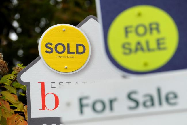For Sale signs. as around one in 25 home buyers using the Government's Help To Buy equity loan scheme in England had household incomes over £100,000, the National Audit Office said