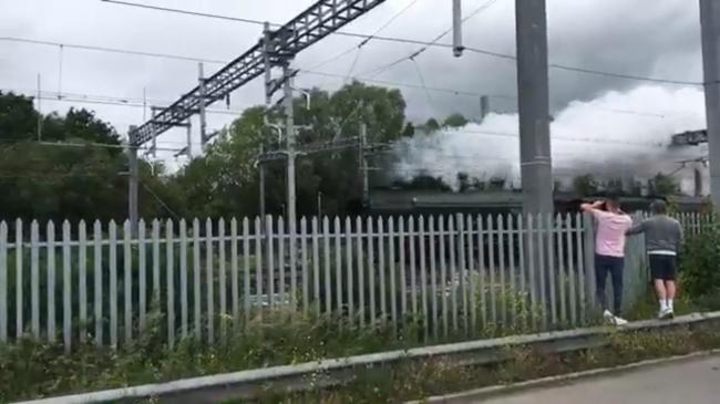 Steam enthusiasts line track to greet Flying Scotsman as it passes through Swindon